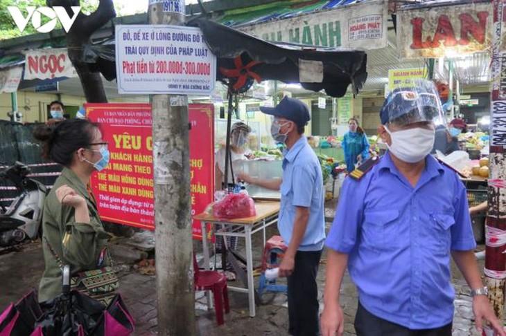 Ngày đầu tiên người Đà Nẵng dùng thẻ đi chợ phòng ngừa Covid-19 - ảnh 14