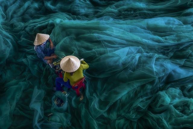 Ảnh người phụ nữ phơi cá của Việt Nam là bức ảnh du lịch đẹp nhất - ảnh 4