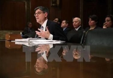 米財務省高官「通貨安競争の回避重要」 G20で主張へ  - ảnh 1