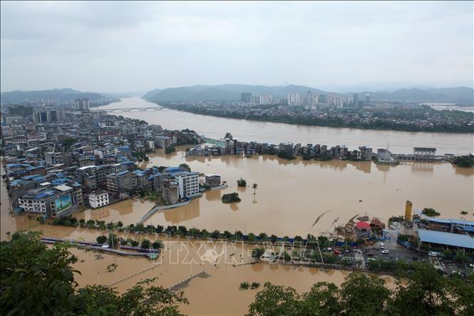 中国、観測開始以来の大雨 33河川で水位過去最高 - ảnh 1