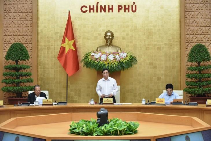 チン首相、初の政府会議を主宰 - ảnh 1