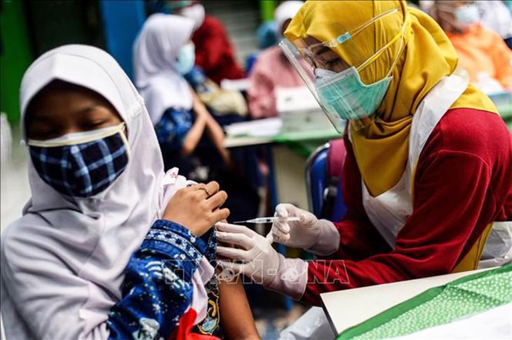 新型コロナ 世界の感染者1億9316万人 死者414万人 - ảnh 1