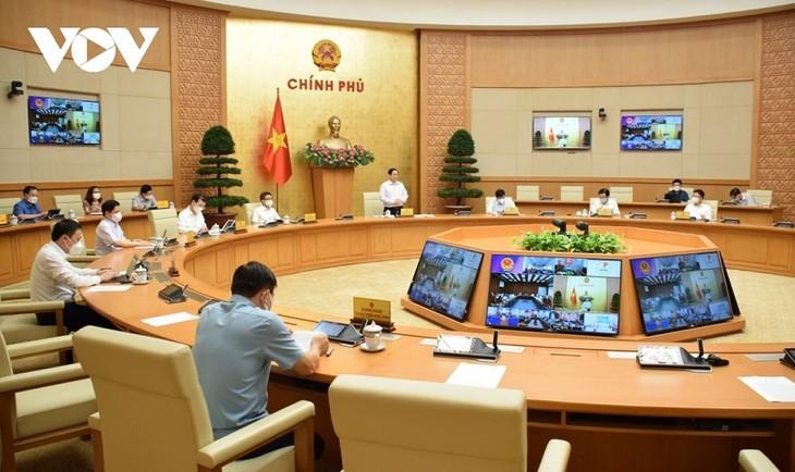ティエンザン省とキエンザン省 遅くとも9月30日までに新型コロナを制圧すべき=チン首相 - ảnh 1