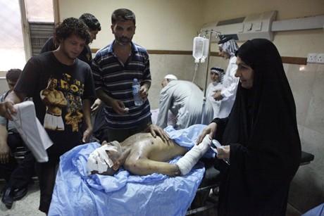 伊拉克各地连发爆炸袭击事件,死亡人数升至110人 - ảnh 1