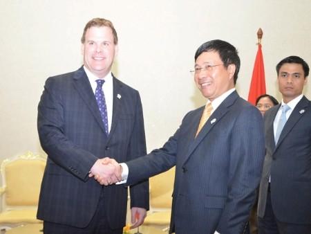 张晋创会见加拿大外交部长约翰.贝尔德 - ảnh 2