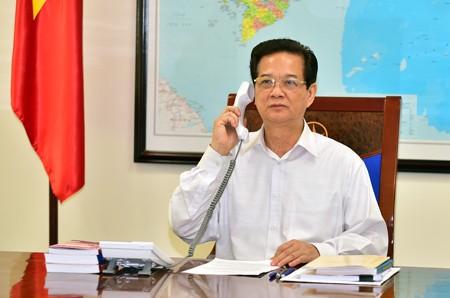 越南政府总理阮晋勇同澳大利亚总理托尼·阿博特通电话 - ảnh 1