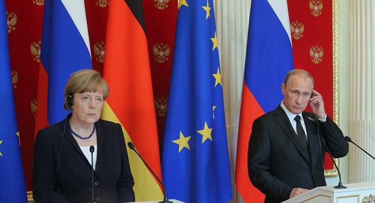 德国和俄罗斯共同呼吁通过外交方式解决双边问题 - ảnh 1