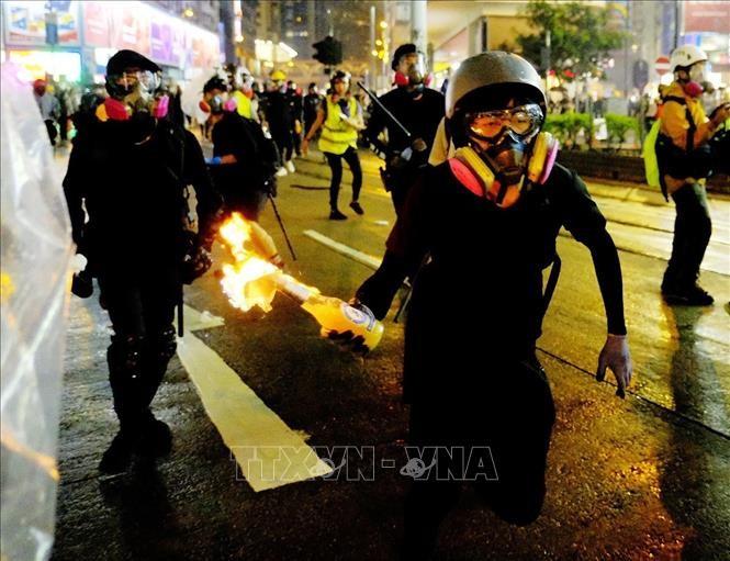 中国香港特区政府对示威者的违法行为予以强烈谴责 - ảnh 1