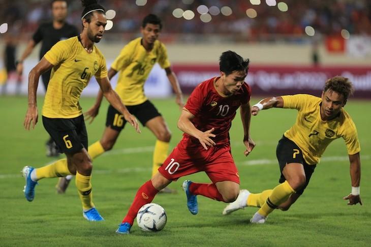 新冠肺炎疫情: 2022年世界杯亚洲区预选赛第二轮 越南队的各场比赛被推迟 - ảnh 1