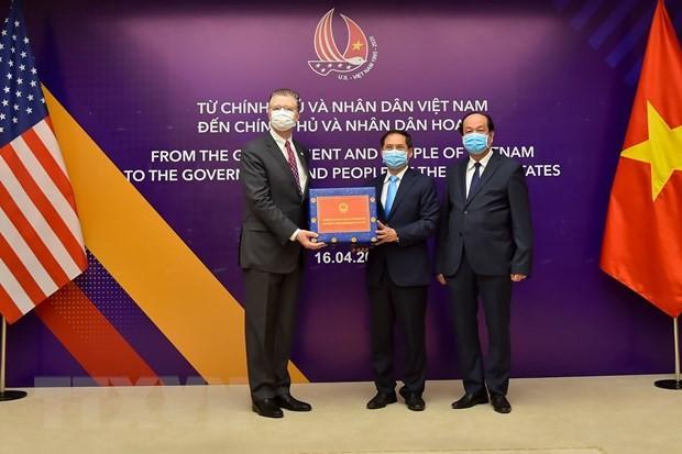 越南积极为防控疫情国家协助 - ảnh 1