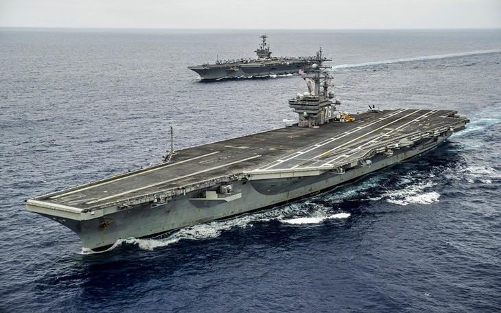 美国派遣两艘航空母舰参加在东海的军演 - ảnh 1