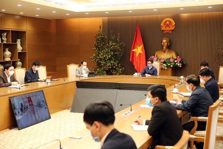 越南政府副总理武德担:主张大规模进行新冠病毒检测 - ảnh 1