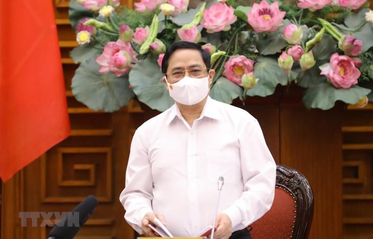 越南政府总理范明政呼吁全民携手抗击疫情 - ảnh 1