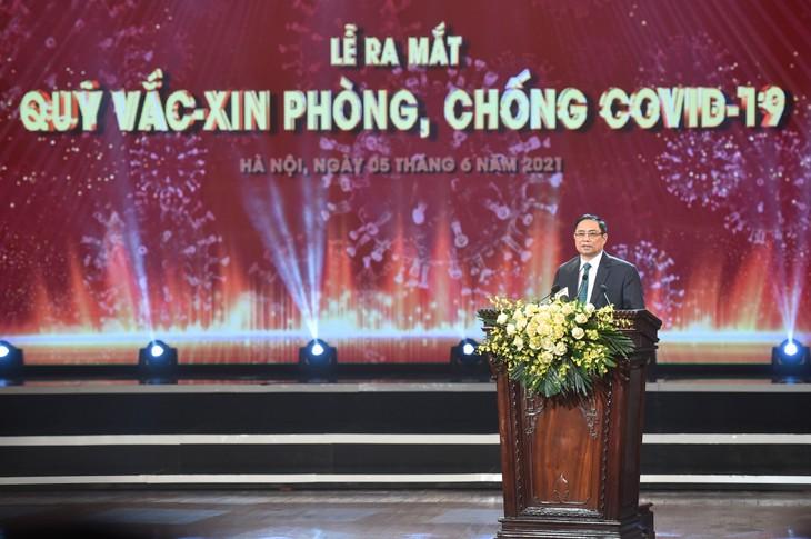 越南新冠肺炎疫苗基金会收到近1.3万亿越盾 - ảnh 1