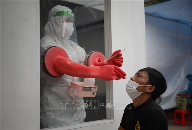 将移动式新冠病毒核酸采样工作站移交给北江省 - ảnh 1