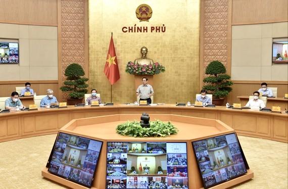 越南政府总理范明政:将在9月30日前逐步放宽社会隔离控制 - ảnh 1