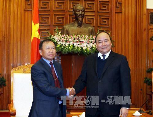 Deputi PM Nguyen Xuan Phuc menerima Badan Pengarahan Pusat urusan Pengembangan Pedesaan Laos - ảnh 1