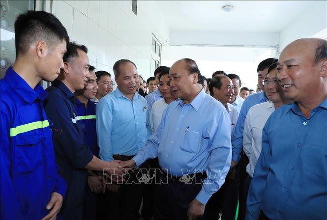 Premierminister Nguyen Xuan Phuc besucht Arbeitnehmer des Bergwerks Ha Lam - ảnh 1