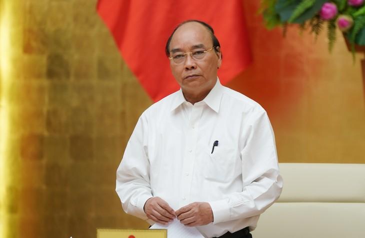 Covid-19: Der Premierminister fordert zur Förderung der Anwendung der Informationstechnologie zur Spurensuche auf - ảnh 1