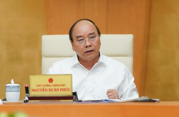 Premierminister Nguyen Xuan Phuc: Den Geist der Wachsamkeit bei der Epidemie-Vorbeugung und –Bekämpfung hervorheben - ảnh 1