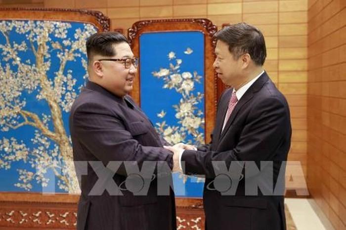 朝鲜领导人金正恩与中国官员讨论加强关系问题 - ảnh 1