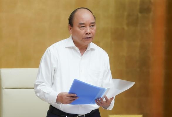 Premierminister Nguyen Xuan Phuc leitet die Regierungssitzung über Covid-19 - ảnh 1