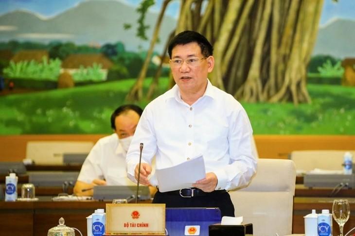 Ständiger Parlamentsausschuss verständigt sich mit Befreiung und Senkung der Steuern für Unternehmen und Bürger - ảnh 1