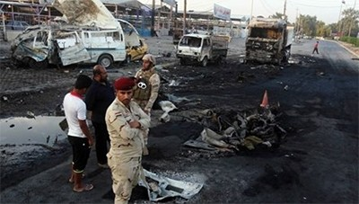 Terjadi serentetan serangan bom berdarah-darah di Irak - ảnh 1
