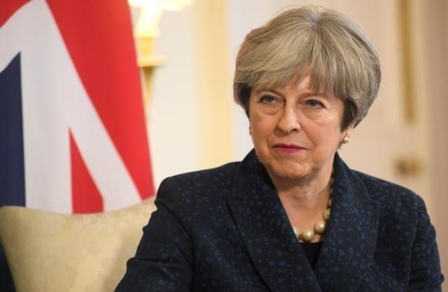 "Masalah Brexit: PM Inggris memperingatkan ""rekening perceraian"" bergantung pada permufakatan dagang terakhir - ảnh 1"