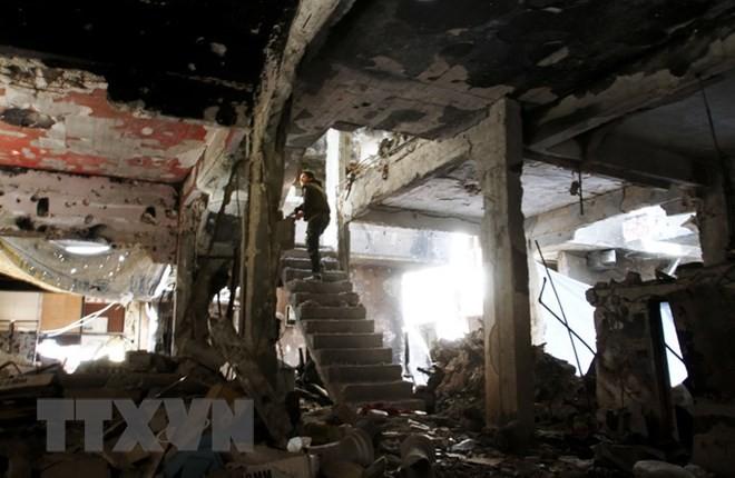 Suriah: Tentara Pemerintah terus memundurkan IS di Damaskus Selatan - ảnh 1
