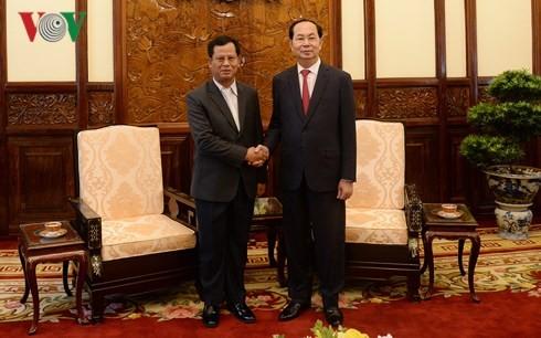 Presiden Vietnam, Tran Dai Quang menerima Deputi Menteri Keamanan Laos - ảnh 1