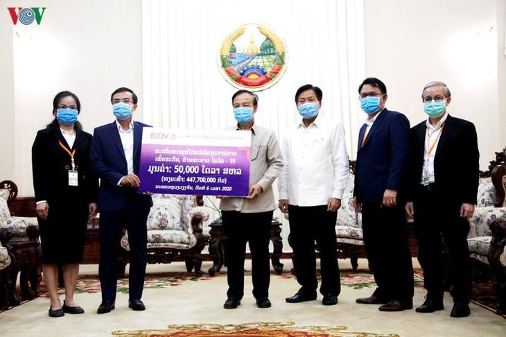 Laos menilai tinggi bantuan Vietnam dalam mencegah dan memberantas Covid-19 - ảnh 1