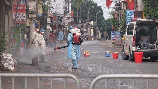 Terus konsisten dengan 5 prinsip melawan wabah Covid-19 di Vietnam - ảnh 1
