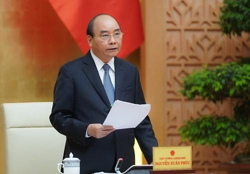 PM Nguyen Xuan Phuc: Menggunakan peluang untuk membangkitkan perekonomian - ảnh 1