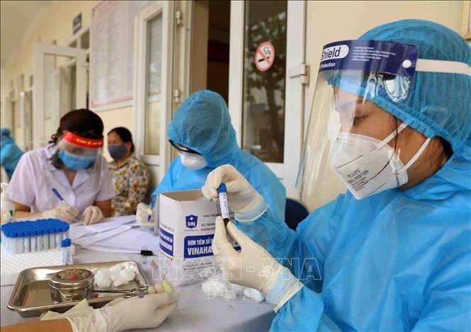 Cepat membangun rezim pemeriksaan dan pengobatan Covid-19 terhadap anggota kantor Vietnam di luar negeri  - ảnh 1
