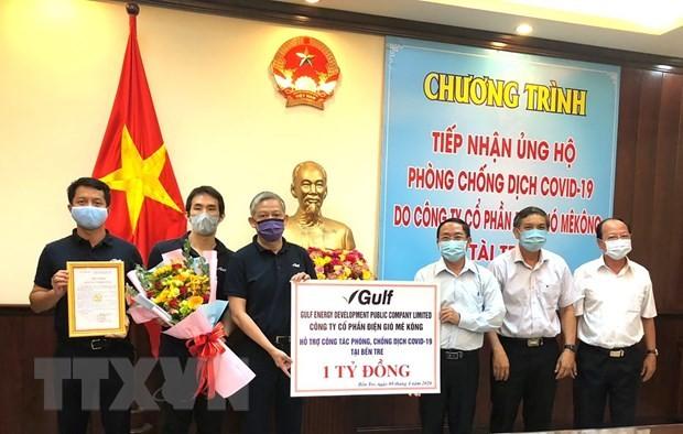 Badan usaha Thailand memberikan bantuan keuangan sebanyak 1 miliar VND kepada Provinsi Ben Tre untuk mencegah dan menanggulangi wabah Covid-19 - ảnh 1