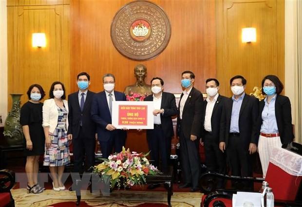 Orang Vietnam di luar negeri mendukung usaha melawan Covid-19 - ảnh 1