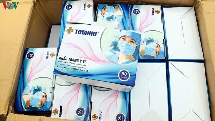 Memberikan 80.000 masker kesehatan kepada Pemerintah dan rakyat Jerman - ảnh 1