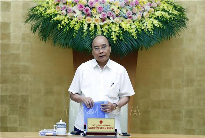 Badan Harian Pemerintah Vietnam mengadakan sidang tematik tentang pencegahan dan penanggulangan Covid-19 - ảnh 1