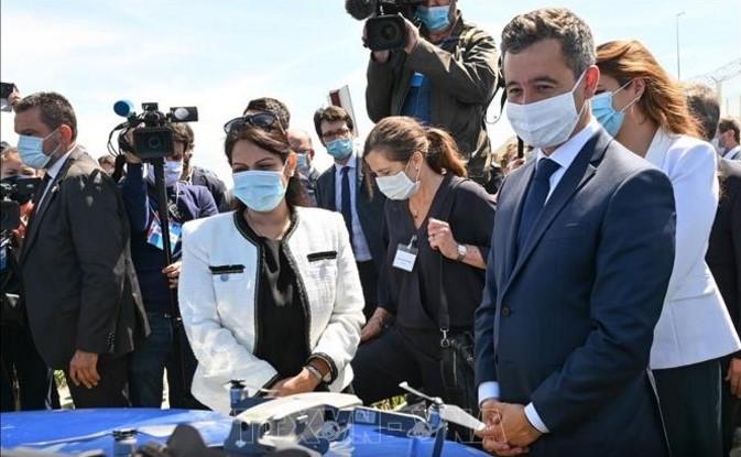Inggris dan Perancis menandatangani permufakatan untuk mencegah perdagangan manusia - ảnh 1