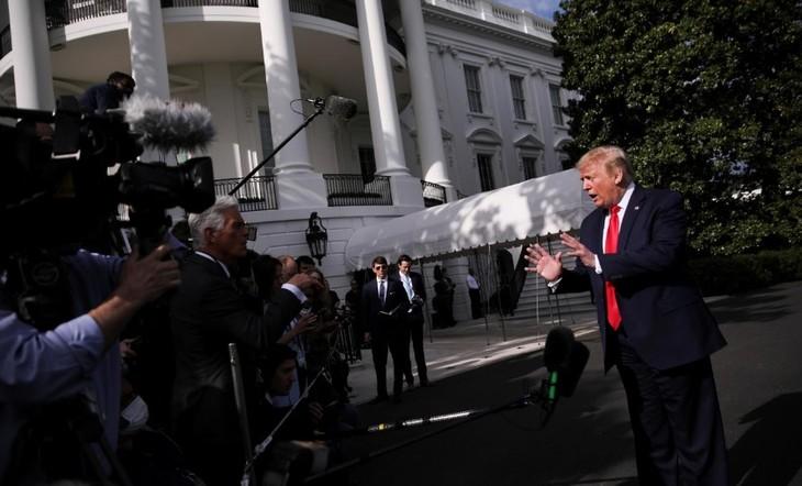 Trump warns of raising tariffs against Chinese goods - ảnh 1