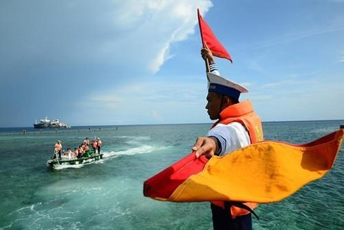 Соблюдение международного права, решительная и постоянная защита национального сувереритета над морем и островами - ảnh 1