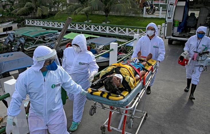 ВОЗ сильно обеспокоена ситуацией с пандемией в Центральной и Южной Америке  - ảnh 1