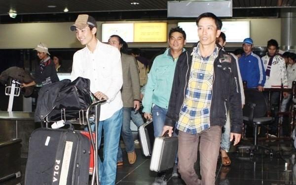 184 tenaga kerja dari Libia pulang ke Hanoi - ảnh 1