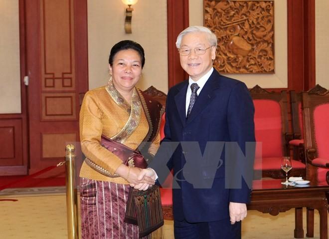 Sekjen KS PKV menerima Delegasi Departemen Hubungan Luar Negeri Partai Rakyat Revolusioner Laos - ảnh 1