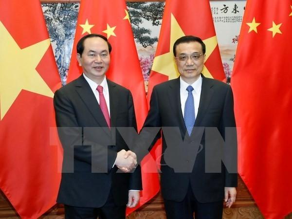 President Tran Dai Quang meets Chinese Premier Li Keqiang  - ảnh 1