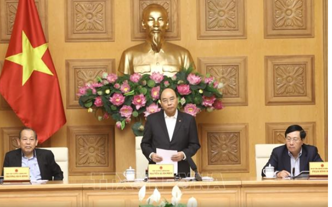 Prime Minister orders fighting Covid-19 and developing economy  - ảnh 1