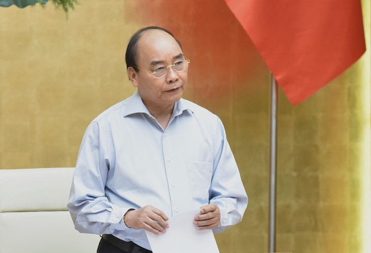 Effective COVID-19 response provides opportunity for Vietnam to lure investment: PM  - ảnh 1