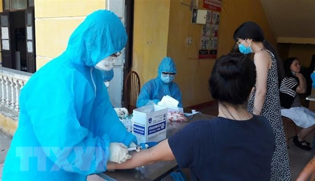 Vietnam reports no community infection of COVID-19 for 94 straight days  - ảnh 1