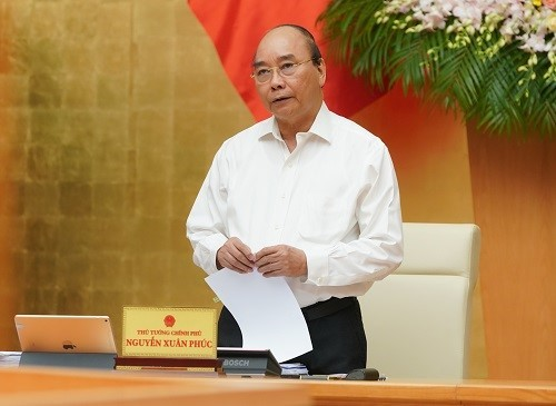 Government determined to fight epidemic, boost economy - ảnh 1
